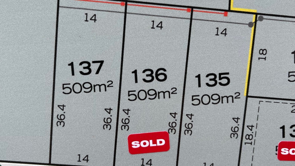 Sold sticker on lot 136 of a masterplan for a new development. This is where we will build our house.