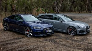 Audi RS5 in front of an Andi RS4 Avant, front 3/4 view.