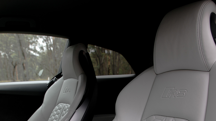 White leather headrests of the front seats of the Audi RS5