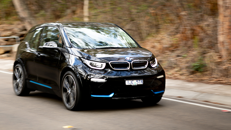 BMW i3S driving left to right of frame.