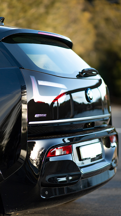 Back of the BMW i3S showing a reflection of a bridge.