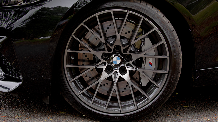 Front-left wheel showing a big brake disk and M-branded brake caliper