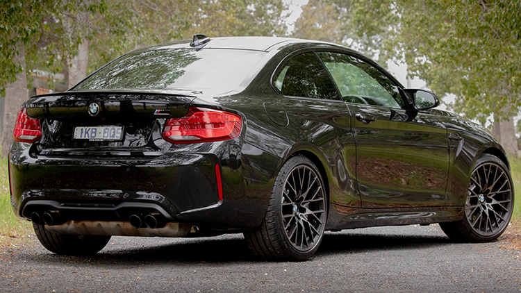 Rear 3/4 view of the BMW M2 Competition.