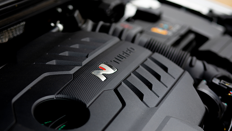 Black plastic engine cover with the stylised N and word turbo.