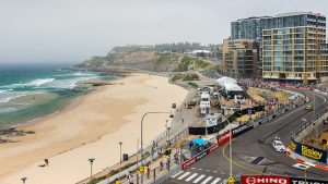 Looking south across Newcastle Beach, the Supercars race track running alongside