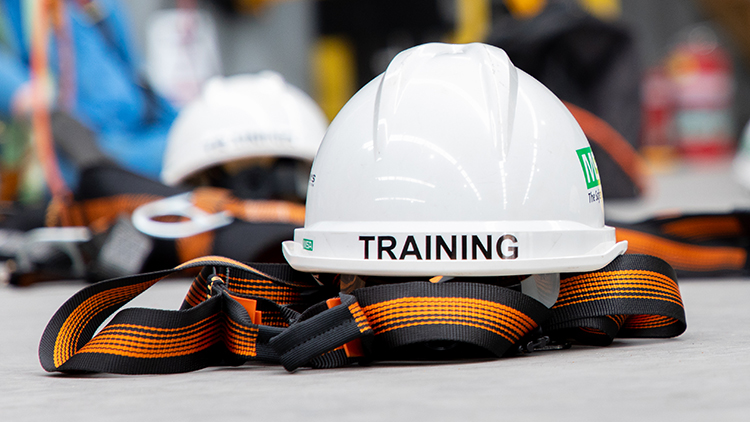 "White hard hat with ""training"" written on it."